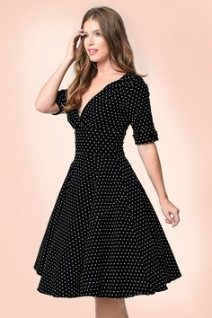 You'll feel like the most beautiful woman when wearing this 50s Delores Polkadots Swing Dress! You'll steal the show when wearing this retro stunner ;-) When you make your entrance in this beauty, all eyes will be on your stunning silhouette, the pleated wrap top and the elegant sleeves with darling details. Not only a fairytale to see but also to wear; she's made from a luxurious, stretchy black cotton blend with a playful white polkadot print. Fabulously classy!   Swing style Lined, p...
