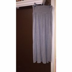 NEW Gray Maxi Skirt This skirt is stunning! It's super soft and it has two slits in the front with a piece coming down in the middle, it's never been worn, just washed once :) pet and smoke free Skirts Maxi