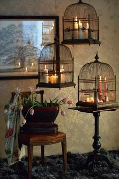 what an inexpensive way to decorate and display candles ... old bird cages.  This would be beautiful on a porch!