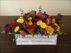 Flower arrangement in a rustic container ... to celebrate teacher's birthday. Mix of calla lilies, African roses, freesias, baby eucalyptus...