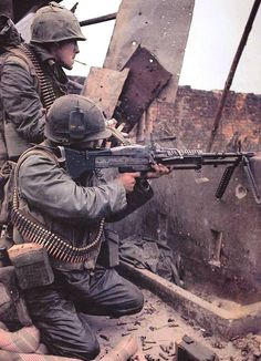 """Animal Mother"" A U.S. Marine M60 Machine Gunner with a fellow comrade during the bloody Battle of Hue City South Vietnam 1968. [1024 x 1418]"