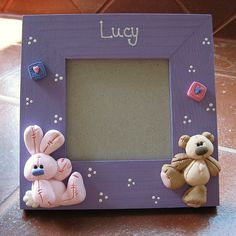polymer clay cuties baby photo frame.....(i got this cute characters on a clay mold!! ooooh, now i have to CLAY! they are so CUTE!...)....