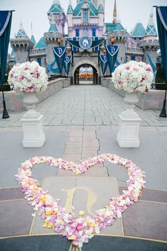 Floral decor at the Sleeping Beauty Castle Forecourt for Kerry and Ben's fairy tale wedding at Disneyland