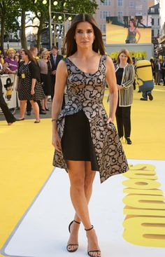 """Sandra Bullock wearing a silver brocade dress, from the #Winter15 Collection, at the """"Minions"""" Premiere in London tonight."""