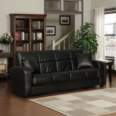 Turn your living room or den into a guestroom with this functional futon sofa sleeper. A couch by day, this leather-look sofa features two cushions and easily converts to a full-size bed for out-of-town guests with just a touch of your hand.