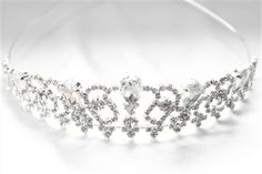 CAD$45.00 - A sparkly rhinestone crystal bridal tiara. It makes an elegant bridal halo, wreath or crown, with a silver wire band for styling convenience.  Karmabridal.com