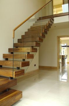 This staircase has an almost floating step effect with open rise steps and off-set stringer support. Each step is clad in high grade natural wood and the staircase is finished with a toughened glass balustrade with rebated matching timber handrail. Floating Staircase, Staircase Railings, Modern Staircase, Staircase Design, Timber Staircase, Bannister, Staircases, Open Stairs, Glass Stairs