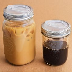 Awesome! These lids turn mason jars into to go drinking glasses. They are called Cuppow!