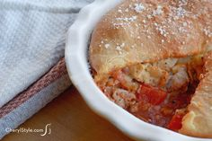 Pizza has never tasted so good. This pizza pot pie recipe substitutes greasy fillings for lean meat and hearty vegetables. It's so good and easy to make!