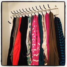 Tank top storage with a tie/belt rack in the closet