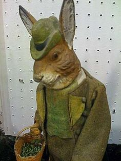 Circa-1900 cloth-dressed rabbit candy container with glass eyes, jointed arms and Easter basket