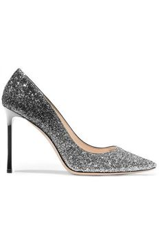 Jimmy Choo's signature 'Romy' pumps are saturated in light-catching glitter that graduates from black to silver. Lined in smooth leather, they have a sleek point-toe profile and a 100mm stiletto heel. Wear this eye-catching pair with everything from jeans to dresses.