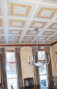 This dining room ceiling mural adds a fantastic creative element to this Indianapolis home.