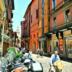 Scooter street scene at noon in Bologna - Instagram by @traveldudes