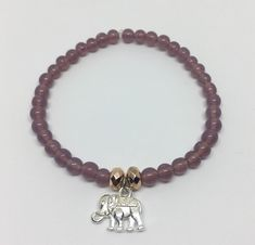 Purple beaded bracelet with a cute elephant charm pendant - perfect for all you elephant lovers out there! Making Bracelets With Beads, Cute Bracelets, Beaded Bracelets, Elephant Jewelry, Animal Jewelry, Homemade Jewelry, Hamsa Hand, Purple Roses, Crystal Pendant