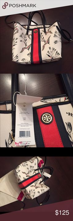 Tory Burch mini square tote in ecru/navy/red Never carried -- notice the plastic protector still on the name badge! Perfect for year-round use Cape Floral pattern with Kerrington Stripe. Dust bag included! Mini may be misleading as this purse is 11 inches long, 5 inches wide, & 11 inches tall. Has removable shoulder strap & 2 inside pockets! Search Tory Burch purses & you will find that this is a bargain. Tory Burch Bags Shoulder Bags