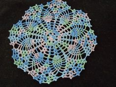 new pineapple and fan doily, verigated blue, green lavender, added to my etsy shop
