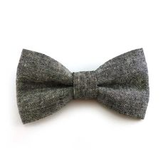 A smart and stylish clip on bow tie in a charcoal black linen and cotton blend fabric. This bow tie looks great on both men and women and is available in an adult/teen size. The bow portion measures approximately 4.5 x 2.5 (11.4 x 6.4 cm) and has a metal bow tie clip stitched securely to the back. The last picture is an example of the style of bow tie clips used. If you need quantities over what is available message me and I can get a more accurate count of availability for you. The chambray…