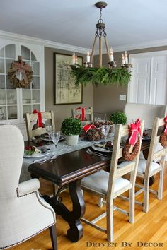Classic dining room, fresh greens on chandelier - Driven by Decor - Our Christmas Home Tour