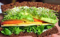 Baggin's Veggie sandwich  Cream cheese, mayo, Swiss cheese, American cheese, sprouts, lettuce, tomato, cucumber, avocado, onion on 12 grain bread