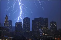 Lightning pierced the sky above downtown as a series of violent thunderstorms rumbled through Greater Boston. Boston Globe.