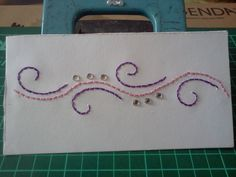 used paper embroidery and stick-on jewels- the ones that come in a sheet for embellishing phones.
