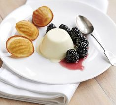 Creamy panna cotta, plump British blackberries and warm honey madeleines make a special dessert with very little effort