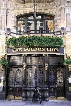 The Golden Lion Pub England - Located in the posh St James's area of London, the Golden Lion can trace its history back over three centuries. The present building is around a century old. The pub contains a Theatre Bar upstairs. British Pub, Old Pub, London United Kingdom, Pub Signs, London Pubs, Shop Fronts, England And Scotland, London Calling, London England