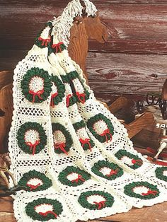 Holiday Delight Afghan  Everyone will love this festive Christmas afghan strewn with evergreen wreaths.  Designed by Maggie Weldon  free pdf from free-crochet.com