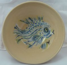 """The Ultimate 2016 Summer Bowl Blue Fish Bowls (only 2 left) Collaboration with Timothy Bailey Dimensions (approximately): (h) 2"""" x (w) 6"""" Material Used:  Thrown stoneware Interior Colors:  Underglaze paints with clear, glossy glaze Exterior Color:  Peach Blush"""