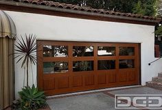 Modern Spanish Style Wood Garage Doors Made to Your Specifications! Cheap Garage Doors, Garage Door Windows, Glass Garage Door, Wood Garage Doors, Garage Door Design, Wooden Doors, Custom Garage Doors, Contemporary Garage Doors, Modern Garage Doors