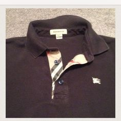 Burberry boys shirt. Navy. Fits size 4-5. 100% authentic boys burberry shirt. Pre loved! Normal signs of wear but still In good condition. Burberry Shirts & Tops Polos