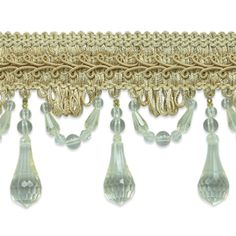 """The Juliet beaded trim measures approximately 3 1/2"""" from the top of the stitched gimp to the bottom of the beaded strand. The stitched gimp measures approximately 1"""" in width and scalloped beaded trim measures 2 1/2"""" in length. The drop crystal bead is separated by scalloped beads approximately 1 1/4"""" apart. Contents91% Polyester, 4% Other Fibers, 5% Acrylic Care InstructionsHand Wash,..."""