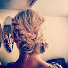 The braided bun is one of our favorite styles for #prom or #weddings.