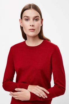 COS image 9 of Round-neck wool jumper in Brick red