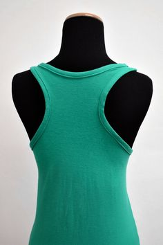 Racerback tank tops are usually made out of cotton jersey and are a great item to wear under blouses or on its own. In this tutorial I will show you how to create your own racerback tank top from scratch. 592...