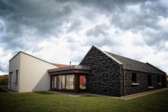 "BMCA Architects Limited created a replacement concept design for this dwelling inspired by traditional forms and layout of the existing and former ""central hearth byre dwelling"" Architecture Courtyard, Timber Architecture, Courtyard Design, Courtyard House, Interior Design Northern Ireland, Cottage Extension, Garage Extension, House Designs Ireland, Modern Bungalow"
