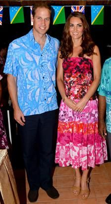 Britain's Prince William, left, and wife Kate, the Duchess of Cambridge, right, pose for a photo in Honiara, Solomon Islands, Sept. 16, 2012. (William West-Pool/Getty Images)