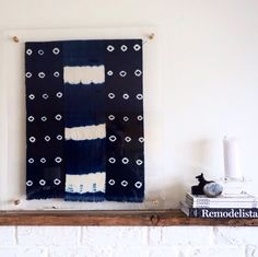 Authentic African indigo cloth showcased between two clear lucite panels.
