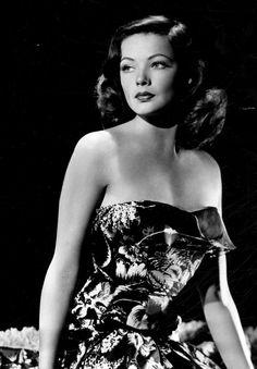 Gene Tierney, 1945 glam photo print ad portrait movie star floral tiki dress strapless full skirt mid 40s island pin up girl hawaii