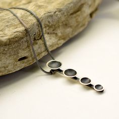 Sterling silver contemporary necklace bar and disc pendant oxidized matte silver necklace domed circles minimalist necklace modernist by nikiforosnelly on Etsy https://www.etsy.com/uk/listing/507734392/sterling-silver-contemporary-necklace