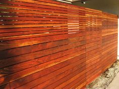 Fence with a wood gate built with clear redwood.  6 ft tall with 3.5 inch slats on bottom, 1.5 in slats on top. The fence is 42 ft long with a 3 ft x 6 ft gate