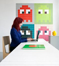 """ixxi is a modular hanging system that joins cards together in a pattern to create wall art. The Dutch company lets you enlarge a single image, create a collage, or create an abstract pixelated piece of your choice."" Pacman! Pacman!"
