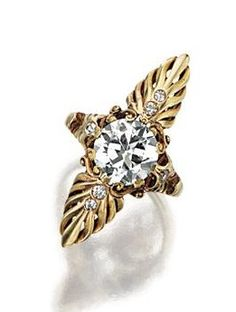 GOLD AND DIAMOND RING, CARTIER, CIRCA 1920. The elongated navette-shaped mounting designed as palmette motifs centering an old European-cut diamond weighing 1.85 carats, further decorated with 6 small single-cut diamonds, size 3 ¾, signed Cartier and 14K.