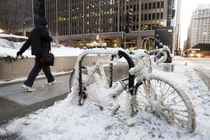 A man walks past a snow encrusted bicycle with wind chills nearing minus 30 Fahrenheit on Tuesday, Jan. in downtown Chicago. Chicago Travel, Chicago Usa, Chicago Photos, Chicago Skyline, My Kind Of Town, Walk Past, Winter Pictures, Great Lakes, Cold Day