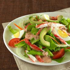 Crab Louis Salad Recipe Lunch and Snacks, Salads with lettuce, lump crab meat, eggs, tomatoes, avocado, fennel bulb, carrots, nonfat plain greek yogurt, low-fat buttermilk, chile sauce, onion, garlic, finely chopped fresh parsley, ground cayenne pepper, sea salt