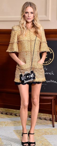 Head to toe Chanel: Poppy was dressed in Chanel as she supported her sister at the show...