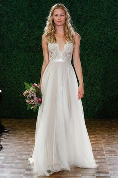 Watters 2015 Collection | Satina's gorgeous lace neckline and flowing silhouette makes us swoon.  View the full collection of wedding gown couture at SingaporeBrides.com