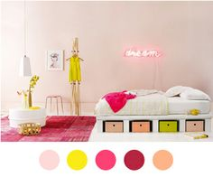 The room's a bit cutesy, but oh those drawers! And that color palette!