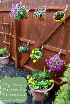 Pipe Hanger / Clay pot hangers - good idea for herb garden.:) **good tip for spray painting you pots (water seal the interior) first to keep the paint from peeling off the outside. Nice new fence for us Fence Planters, Diy Planters, Fresco, Pot Hanger, Plant Markers, My Secret Garden, Terracotta Pots, Diy Arts And Crafts, Herb Garden